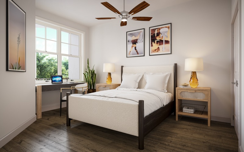 bedroom with large bed, side tables and desk
