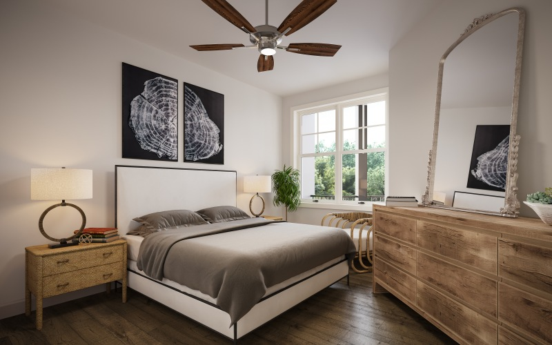bedroom with large bed, side tables and dresser