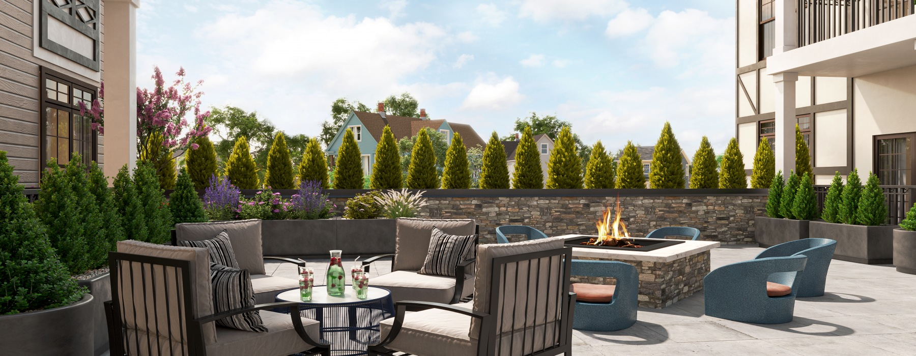 outdoor courtyard with fire pit and seating area